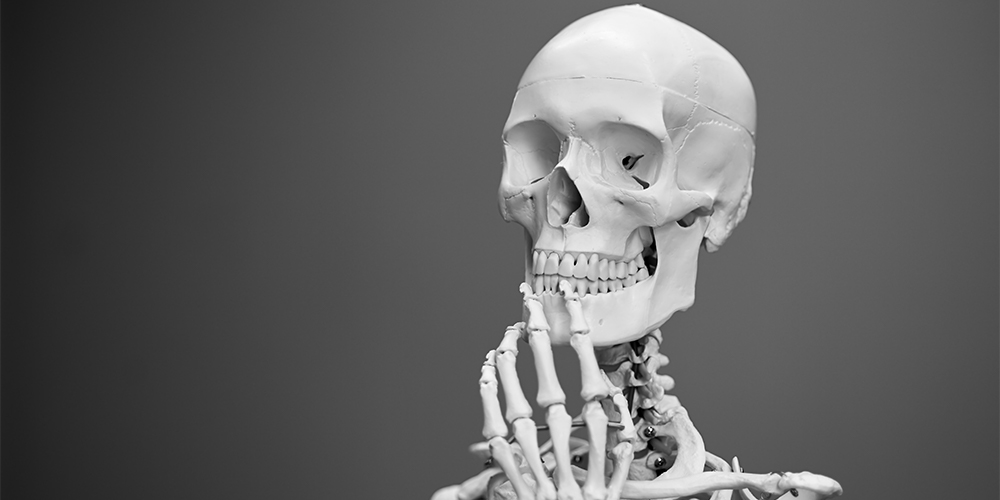 Skeleton posing in a thoughtful manner
