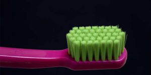 Closeup of a Pink Toothbrush