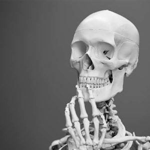Skeleton assuming a thinking pose